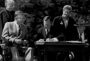 President George H. W. Bush signs the ADA into law 1990